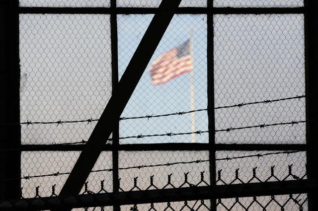 FILE PHOTO: The flag over a war crimes courtroom in Camp Justice at US Naval Base Guantanamo Bay in Cuba in this photo reviewed by the U.S. Department of Defense on October 17, 2012, day three of pre-trial hearings for the five Guantanamo prisoners accused of orchestrating the 9/11. REUTERS/Michelle Shephard/Pool