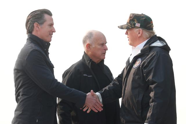 FILE PHOTO: U.S. President Donald Trump shakes hands with California's then-Governor-elect Gavin Newsom (L) after greeting then-Governor Jerry Brown (C) upon arriving at Beale Air Force Base, California, U.S., November 17, 2018. REUTERS/Leah Millis/File Photo