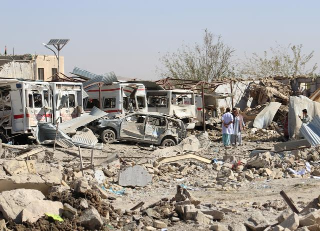 Damaged vehicles are seen at the site of a car bomb attack in Qalat, capital of Zabul province, Afghanistan September 19, 2019. REUTERS/Stringer