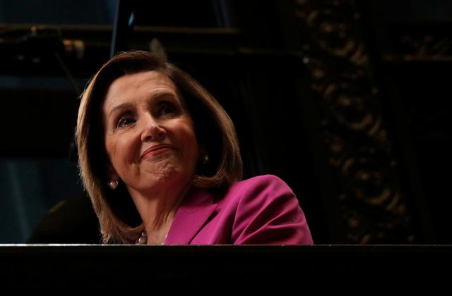 FILE PHOTO: U.S. House Speaker Nancy Pelosi (D-CA) looks down from a balcony during an interview with CNBC at the New York Stock Exchange (NYSE) in New York, U.S., September 17, 2019. REUTERS/Brendan McDermid