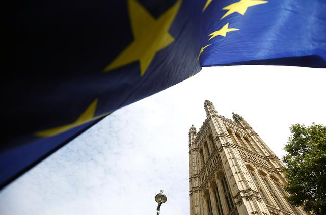 FILE PHOTO: A flag of the European Union is pictured outside the Houses of the Parliament in London, Britain August 28, 2019. REUTERS/Henry Nicholls