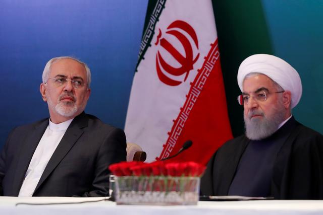 FILE PHOTO:  Iranian President Hassan Rouhani (R) and Foreign Minister Mohammad Javad Zarif attend a meeting with Muslim leaders and scholars in Hyderabad, India, February 15, 2018. REUTERS/Danish Siddiqui