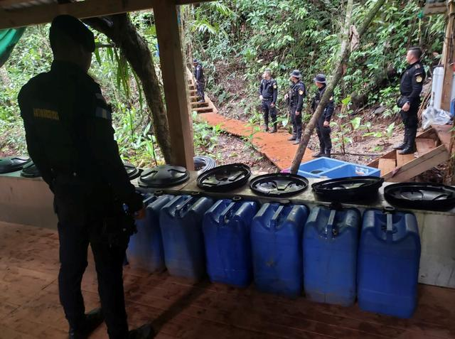 Agents of the Guatemalan National Civil Police (PNC) are seen during an operation to dismantle a coca processing lab in Izabal, Guatemala September 19, 2019. National Civil Police/Handout via REUTERS