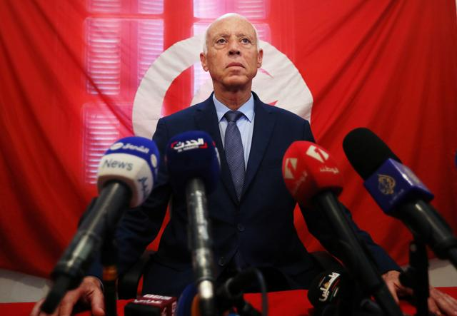 Presidential candidate Kais Saied speaks as he attends a news conference after the announcement of the results in the first round of Tunisia's presidential election in Tunis, Tunisia September 17, 2019. REUTERS/Muhammad Hamed