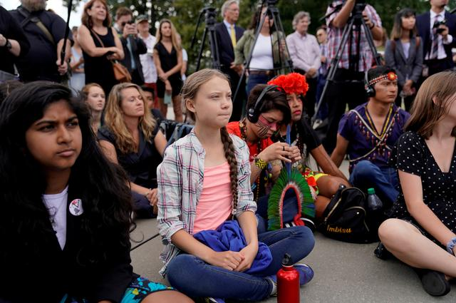 Sixteen year-old Swedish climate activist Greta Thunberg listens to speakers during a climate change demonstration at the U.S. Supreme Court in Washington, U.S., September 18, 2019. REUTERS/Kevin Lamarque