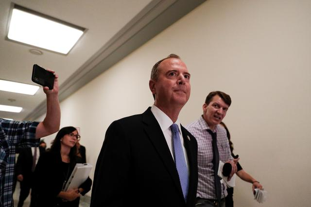 FILE PHOTO: House Intelligence Committee Chairman Adam Schiff (D-CA)  walks into a members only committee room ahead of a hearing on Capitol Hill in Washington, U.S., July 24, 2019. REUTERS/Tom Brenner