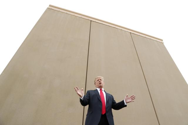 FILE PHOTO: U.S. President Donald Trump speaks while participating in a tour of U.S.-Mexico border wall prototypes near the Otay Mesa Port of Entry in San Diego, California. U.S., March 13, 2018. REUTERS/Kevin Lamarque