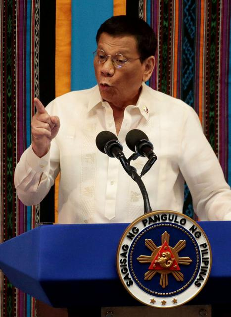 FILE PHOTO: Philippine President Rodrigo Duterte gestures during his fourth State of the Nation Address at the Philippine Congress in Quezon City, Metro Manila, Philippines July 22, 2019. REUTERS/Eloisa Lopez/File Photo