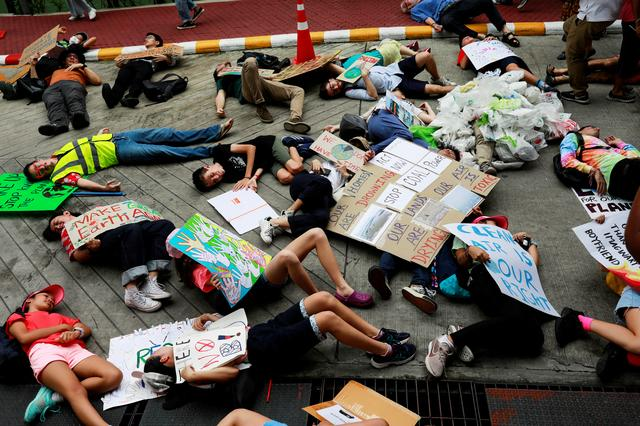 Environmental activist play dead as they participate in a Global Climate Strike near the Ministry of Natural Resources and Environment office in Bangkok, Thailand September 20, 2019. REUTERS/Soe Zeya Tun