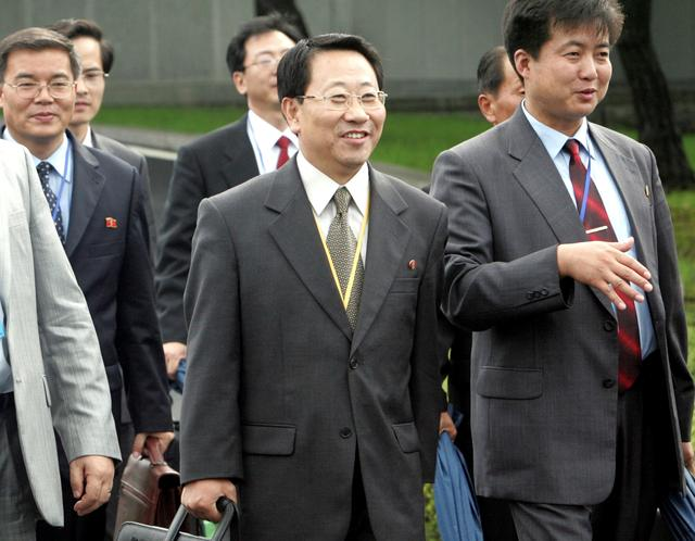 FILE PHOTO: Kim Myong Gil, minister at North Korea's mission to the United Nations, leaves bound for North Korea with other North Korean officials after the second Economy and Energy Cooperation Working Group Meeting in South Korean territory at the truce village in Panmunjom, north of Seoul August 8, 2007. Ahn Young-joon/Pool via REUTERS/File photo