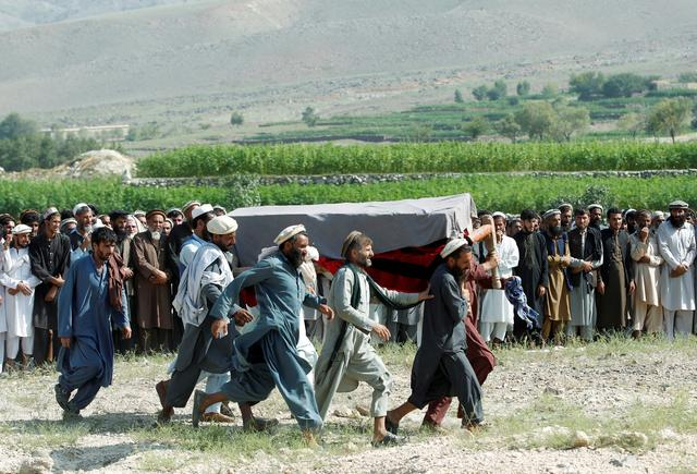 FILE PHOTO: Men carry a coffin of one of the victims after a drone strike, in Khogyani district of Nangarhar province, Afghanistan September 19, 2019. REUTERS/Parwiz/File Photo