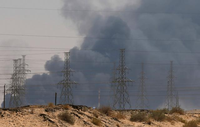 FILE PHOTO: Smoke is seen following a fire at an Aramco factory in Abqaiq, Saudi Arabia, September 14, 2019. REUTERS/Stringer/File Photo