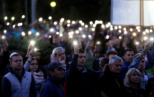 Demonstrators light up their mobile phones as they  attend an anti-government protest rally in reaction to last year's killing of the investigative reporter Jan Kuciak and his fiancee Martina Kusnirova in Bratislava, Slovakia, September 20, 2019. REUTERS/David W. Cerny