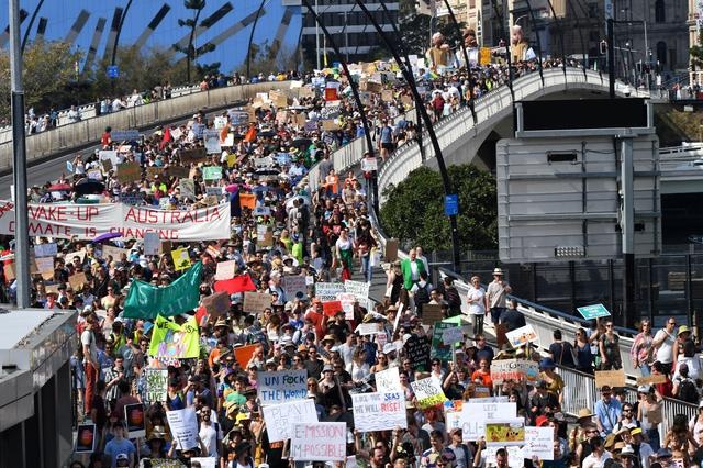 Climate change protesters are seen crossing the Victoria Bridge during the Global Strike 4 Climate rally in Brisbane, Australia, September 20, 2019. AAP Image/Darren England/via REUTERS