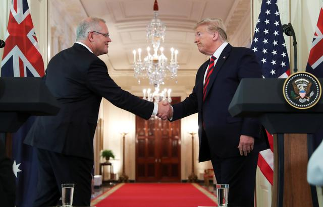 Australia's Prime Minister Scott Morrison shakes hands with U.S. President Donald Trump at the conclusion of a joint news conference in the East Room of the White House in Washington, U.S., September 20, 2019. REUTERS/Jonathan Ernst