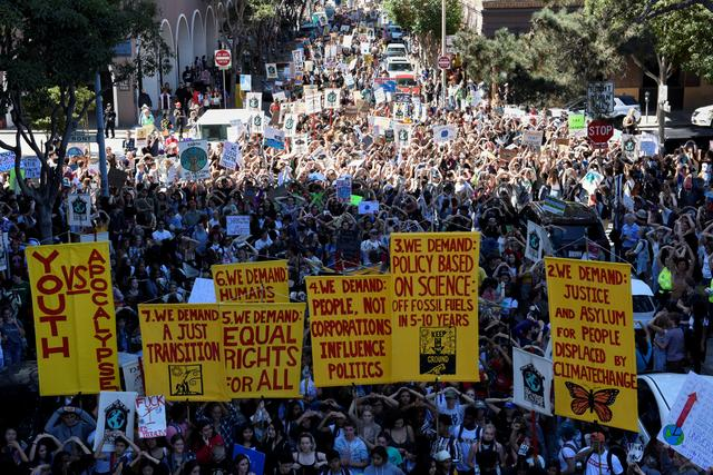 People protest during a Climate Strike march in San Francisco, U.S. September 20, 2019. REUTERS/Kate Munsch