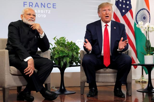 FILE PHOTO: U.S. President Donald Trump speaks as he meets Indian Prime Minister Narendra Modi for bilateral talks during the G7 summit in Biarritz, France, August 26, 2019. REUTERS/Carlos Barria/File Photo