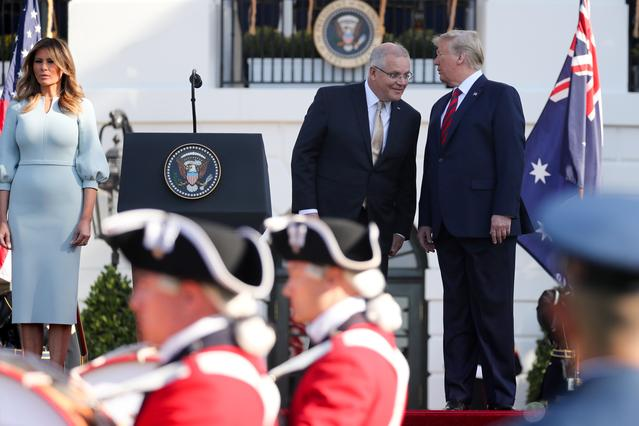 U.S. President Donald Trump and Australia's Prime Minister Scott Morrison chat during an arrival ceremony on the South Lawn of the White House in Washington, U.S. September 20, 2019.  REUTERS/Jonathan Ernst