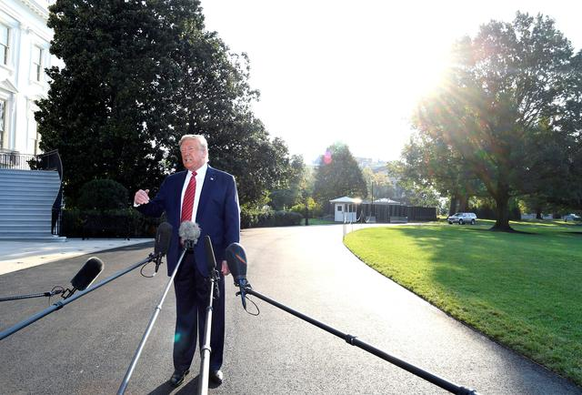 U.S. President Donald Trump responds to reporter's questions as he departs to Texas from the White House, Washington, DC, U.S., September 22, 2019. REUTERS/Mike Theiler