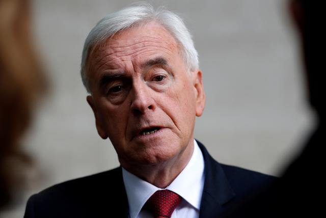 FILE PHOTO: British Labour MP John McDonnell is seen as he leaves the BBC studios in London, Britain September 8, 2019. REUTERS/Peter Nicholls/File Photo