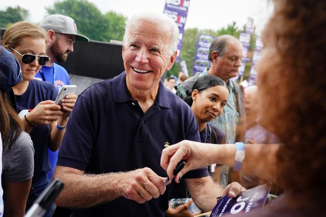 Joe Biden, former U.S. vice president and Democratic presidential hopeful, smiles while signing autographs at the Polk County Democrats' Steak Fry in Des Moines, Iowa, U.S., September 21, 2019.   REUTERS/Elijah Nouvelage