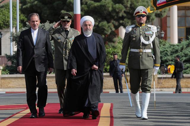 Iranian President Hassan Rouhani walks during a farewell ceremony before leaving for New York, in Tehran, Iran September 23, 2019. Official Iranian President website/Handout via REUTERS