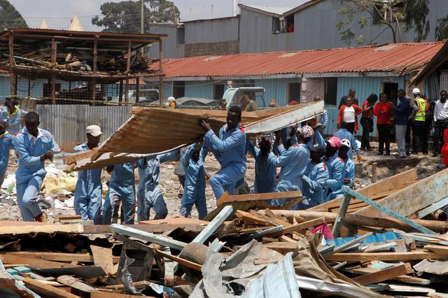 Rescue workers go through the rubble at the site of a collapsed school classroom, in Nairobi, Kenya, September 23, 2019. REUTERS/Njeri Mwangi