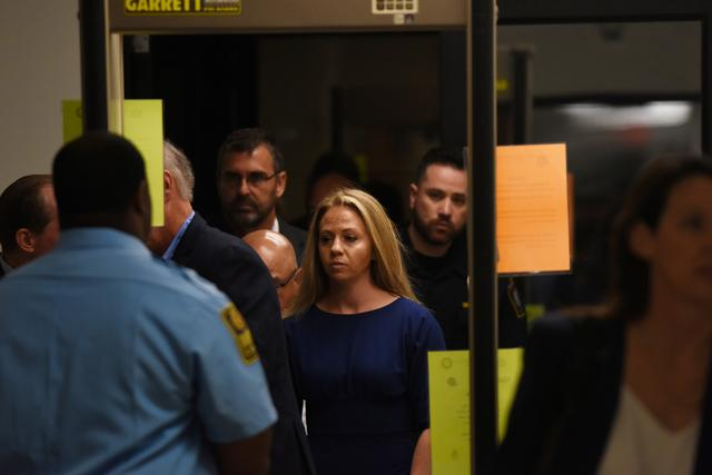 Amber Guyger, who is charged in the killing of Botham Jean in his own home, arrives on the first day of the trial in Dallas, Texas, U.S., September 23, 2019. REUTERS/Jeremy Lock