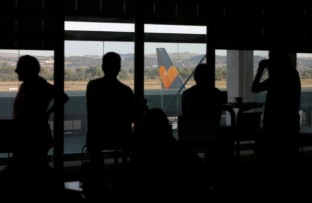 Passengers are seen after Thomas Cook, the world's oldest travel firm collapsed, at Jerez de la Frontera Airport, Spain September 23, 2019. REUTERS/Jon Nazca