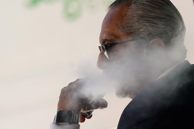 A man uses a vaping product in the Manhattan borough of New York, New York, U.S., September 17, 2019. REUTERS/Carlo Allegri