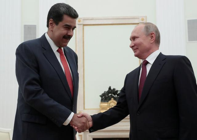 Russian President Vladimir Putin shakes hands with Venezuelan President Nicolas Maduro during a meeting at the Kremlin in Moscow, Russia September 25, 2019.  Sergei Chirikov/Pool via REUTERS