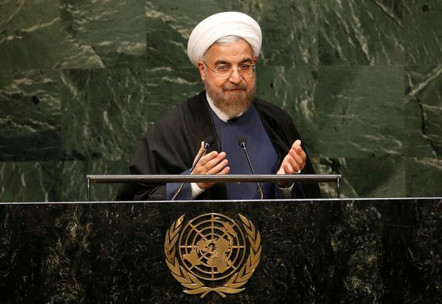 FILE PHOTO: Iranian President Hassan Rouhani gestures at the conclusion of his address to the 69th United Nations General Assembly at the United Nations Headquarters in New York, September 25, 2014.  REUTERS/Mike Segar/File Photo