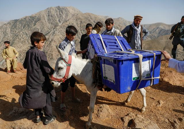 An Afghan man loads ballot boxes and other election material on a donkey to be transported to polling stations which are not accessible by road in Shutul, Panjshir province, Afghanistan September 27, 2019.REUTERS/Mohammad Ismail