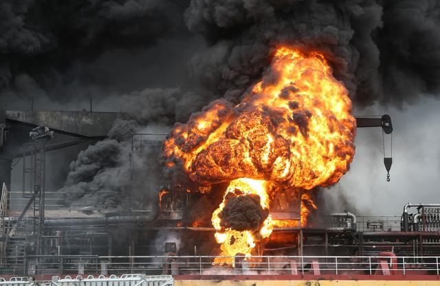 Fire from a vessel is seen at a port in Ulsan, South Korea, September 28, 2019.   Yonhap via REUTERS