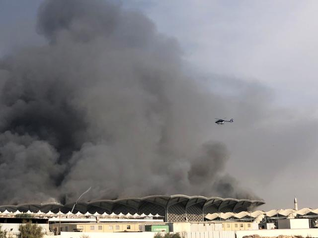 A firefighting helicopter sprays water on a fire at the Haramain high-speed rail station in Jeddah, Saudi Arabia, September 29, 2019. REUTERS/Ismail Nofal
