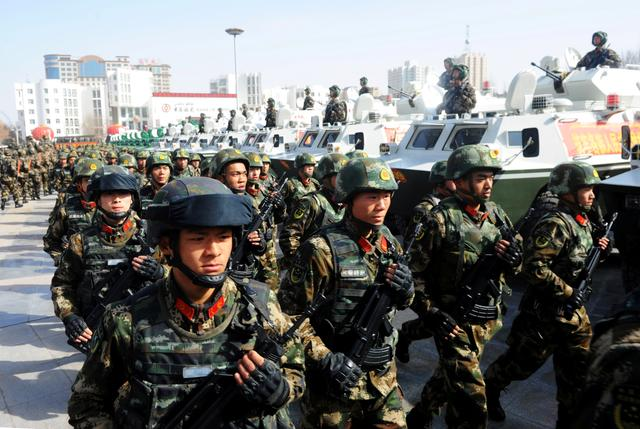 FILE PHOTO: Paramilitary policemen stand in formation as they take part in an anti-terrorism oath-taking rally, in Kashgar, Xinjiang Uighur Autonomous Region, China, February 27, 2017. REUTERS/Stringer/File Photo