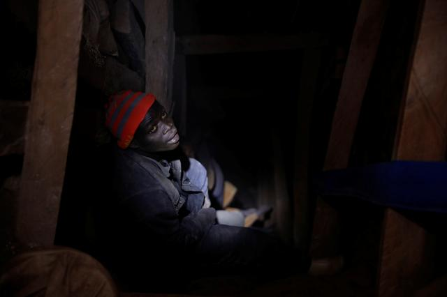 A miner works at the entrance of a shaft at the SMB coltan mine near the town of Rubaya in the Eastern Democratic Republic of Congo, August 16, 2019. REUTERS/Baz Ratner