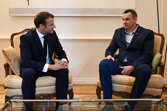 French President Emmanuel Macron speaks with Ukrainian film director Oleg Sentsov at the Permanent Representation of France to the Council of Europe in Strasbourg, France, October 1, 2019. Frederick Florin/Pool via REUTERS