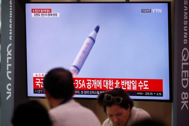 People watch a TV screening of a file footage for a news report on North Korea firing a missile that is believed to be launched from a submarine, in Seoul, South Korea, October 2, 2019. REUTERS/Kim Hong-Ji