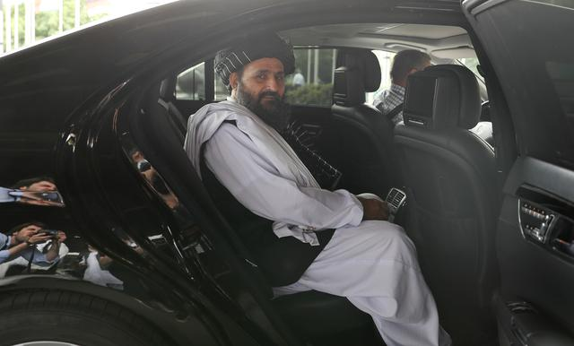 FILE PHOTO: Taliban chief negotiator Mullah Abdul Ghani Baradar sits in a car after the end of peace talks with Afghan senior politicians in Moscow, Russia May 30, 2019. REUTERS/Evgenia Novozhenina