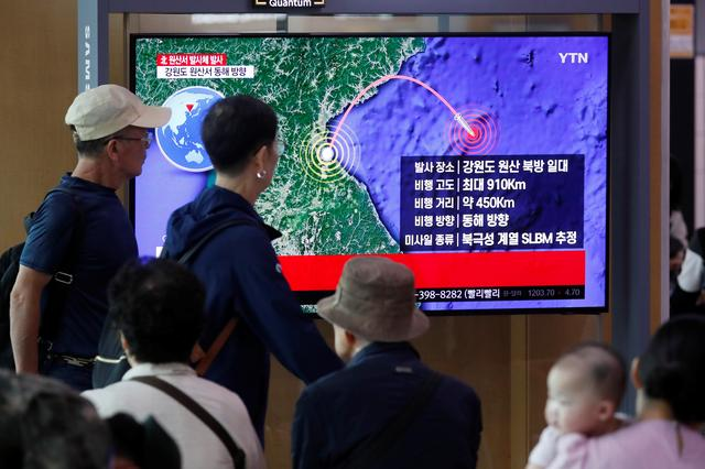 People watch a TV broadcasting a news report on North Korea firing a missile that is believed to be launched from a submarine, in Seoul, South Korea, October 2, 2019. REUTERS/Kim Hong-Ji
