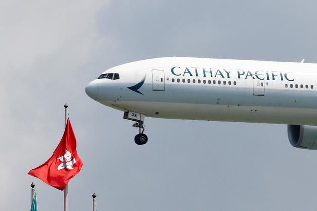 FILE PHOTO: A Cathay Pacific Boeing 777-300ER plane lands at Hong Kong airport after it reopened following clashes between police and protesters, in Hong Kong, China August 14, 2019. REUTERS/Thomas Peter/File Photo