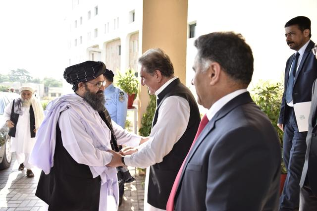 Pakistan's Foreign Minister Shah Mehmood Qureshi welcomes Mullah Abdul Ghani Baradar, who is leading Taliban Political Commission (TPC) delegation, upon his arrival at the Ministry of Foreign Affairs office in Islamabad, Pakistan October 3, 2019. Ministry of Foreign Affairs (MoFA)/ Handout via REUTERS