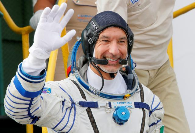 FILE PHOTO: Italian astronaut Luca Parmitano, crew member of the mission to the International Space Station (ISS), waves as he boards prior the launch of Soyuz MS-13 spacecraft Baikonur cosmodrome, Kazakhstan, July 20, 2019. Dmitri Lovetsky