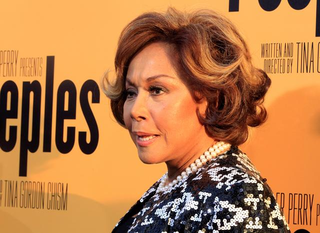 """FILE PHOTO: Actress Diahann Carroll, one of the stars of the new film """"Peeples"""" produced by Tyler Perry arrives at the film's premiere in Hollywood May 8, 2013. REUTERS/Fred Prouser"""