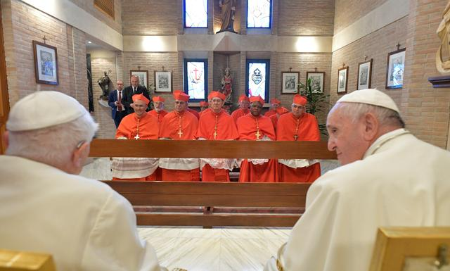 Pope Francis and 13 Roman Catholic prelates meet on a day of a ceremony to elevate them to the rank of cardinal, at Saint Peter's Basilica at the Vatican October 5, 2019. Vatican Media/Handout via REUTERS