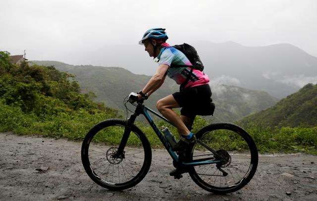 "Mirtha Munoz a 70-year-old runner participates in the Sky Race, Bolivia's toughest cycling competition - Bolivia Skyrace - Yolosa, La Paz, Bolivia - October 5, 2019   Mirtha Munoz in action during the Sky Race. The route known as ""The way of death"" to reach 4000 meters in the Andean mountains   REUTERS/David Mercado"