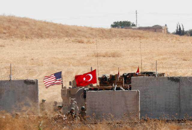 FILE PHOTO: Turkish and U.S. troops return from a joint U.S.-Turkey patrol in northern Syria, as it is pictured from near the Turkish town of Akcakale, Turkey, September 8, 2019. REUTERS/Murad Sezer/File Photo