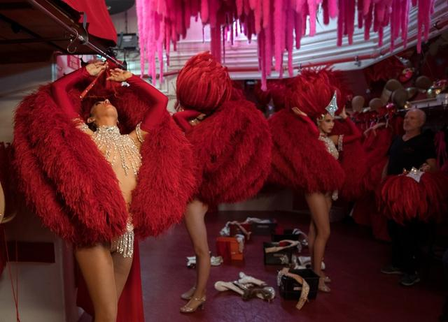 """Dancers get ready for the """"Red"""" set in the review """"Feerie"""" at the Moulin Rouge in Paris, France, July 3, 2018. REUTERS/Philippe Wojazer"""