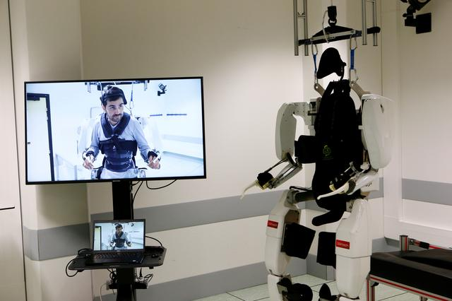 The pioneering four-limb robotic system, or exoskeleton, that is commanded and controlled by signals from the patient's brain is seen following a news conference after Thibault, a 28-year-old man, paralyzed from the shoulders down, had been able to walk using it at the French research center Clinatec in Grenoble, France, October 7, 2019. REUTERS/Emmanuel Foudrot